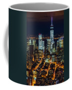 Aerial View Of The Lower Manhattan Skyscrapers By Night Coffee Mug
