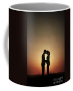 Affectionate Couple At Sunset In Silhouette Coffee Mug