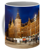 Amsterdam Central Station And Tram Stop At Night Coffee Mug