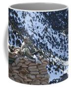 An Afghan Border Patrolman Provides Coffee Mug