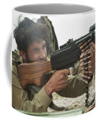 An Afghan Local Police Officer Fires Coffee Mug