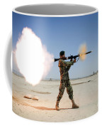 An Afghan National Army Soldier Fires Coffee Mug by Stocktrek Images