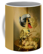 An African Grey And An Orange Winged Amazon Parrot On  A Perch With Grapes Coffee Mug
