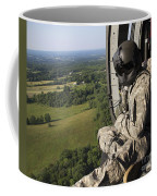An Army Crew Chief Looks Out The Door Coffee Mug