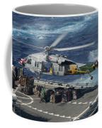 An Mh-60s Sea Hawk Helicopter Picks Coffee Mug