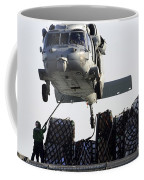 An Mh-60s Sea Hawk Picks Up Supplies Coffee Mug