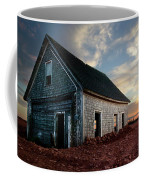 An Old Farm House Sits Partially Buried Coffee Mug