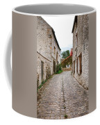 An Old Village Street Coffee Mug by Olivier Le Queinec