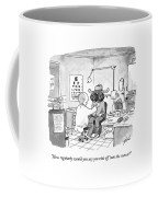 An Optometrist Examines A Cowboy Coffee Mug
