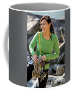 Attractive Female Climber Adjusting Coffee Mug