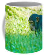 Baby Chimp In The Grass Coffee Mug