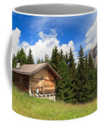 barn on Alpine pasture Coffee Mug
