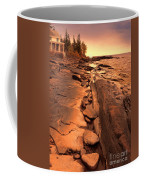Beach House On Rocky Shore Coffee Mug