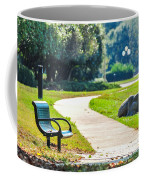 Bench In A Park With A Walkway Coffee Mug