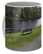 Bench On Shore Of River Ness In Inverness Coffee Mug