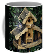 Bird On A House Coffee Mug