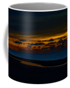 Black Beach With Orange Sky Coffee Mug
