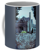 Black Cat On A Stone Wall By House Coffee Mug