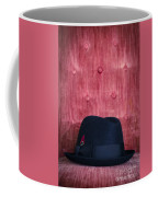 Black Hat On Red Velvet Chair Coffee Mug
