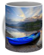 Blue Canoe At Sunset Coffee Mug
