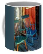 Blue Chair Against Red Door Coffee Mug
