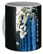 Blue Garden Fence With White Flowers Coffee Mug