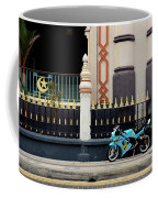 Blue Yellow Sporty Motorcycle Parked On Pavement Coffee Mug