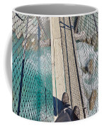 Boots On Swing Bridge Over Troubled White Water Coffee Mug