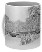 Bow Bridge In Central Park During Snowstorm Bw Coffee Mug by Susan Candelario