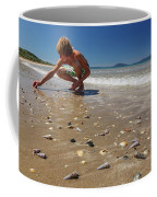 Boy Picking Seashells On The East Coast Coffee Mug