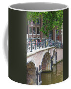 Bridge Over Canal With Bicycles  In Amsterdam Coffee Mug