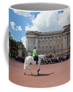 British Royal Guards Riding On Horse And Perform The Changing Of The Guard In Buckingham Palace Coffee Mug