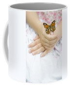 Butterfly Resting On A Girls Hand Coffee Mug