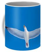 Calling Herring Gull Flying In Blue Sky Coffee Mug