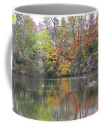 Canadian Goose Swimming Through The Autumn Reflections On The Pond Coffee Mug