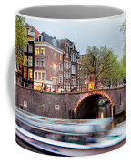 Canal Bridge And Boat Tour In Amsterdam At Evening Coffee Mug