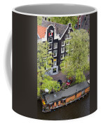 Canal Houses And Houseboat In Amsterdam Coffee Mug
