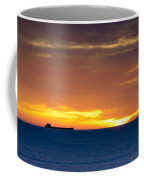Cargo Ship On Horizon At Dawn Coffee Mug