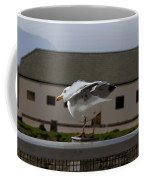 Cartoon - A Bird Perched On A Metal Post Getting Ready To Take Off Coffee Mug