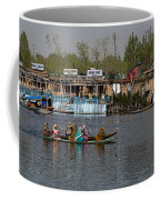 Cartoon - Ladies On 2 Wooden Boats On The Dal Lake With The Background Of Houseboats Coffee Mug