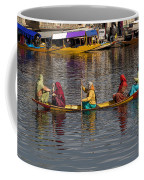 Cartoon - Ladies On A Wooden Boat On The Dal Lake With The Background Of Hoseboats Coffee Mug