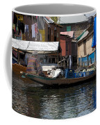 Cartoon - Man Rowing Small Boat Laden With Vegetables In The Dal Lake In Srinagar Coffee Mug