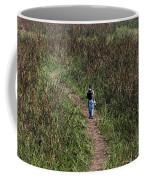 Cartoon - Man Walking Through Tall Grass In The Okhla Bird Sanctuary Coffee Mug