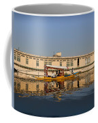 Cartoon - Shikara With Tourists Passing In Front Of A Large Houseboat In The Dal Lake Coffee Mug