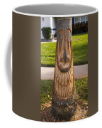 Carving A Happy Tiki From A Palm Tree Stump Coffee Mug