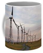 Cattle Graze In Field Next To Windmills Coffee Mug
