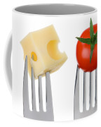 Cheese And Tomato On Forks Against White Coffee Mug