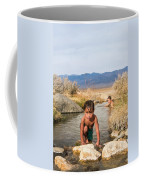 Child And Mother Playing In Hot Springs Coffee Mug