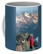 Climber Lights His Ultralight Stove Coffee Mug