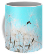 Close-up Dandelion Seeds Against Blue Coffee Mug